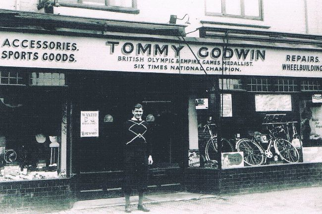 Tommy outside his shop